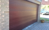 Dark Wood Effect Insulated Roller Garage Door