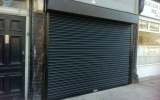 Matt black, powder coated, shop front roller shutter